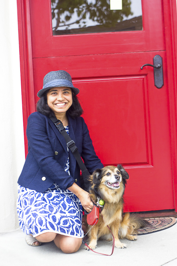 Paroma and Babu, Year of the Monkey, happy woman and dog in front of red door