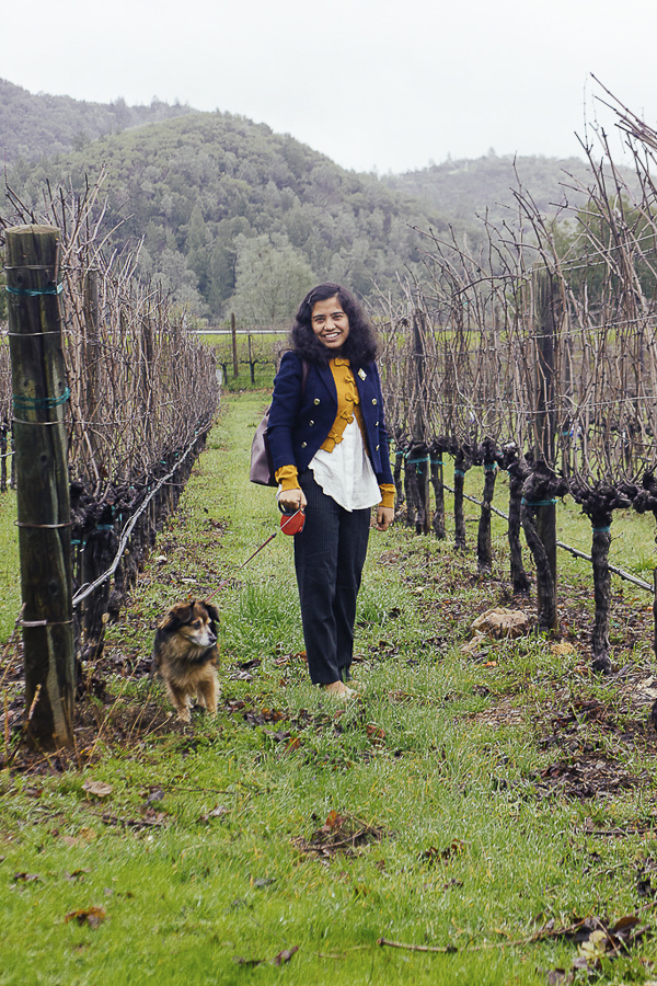 woman and dog in vineyard, pet friendly destinations
