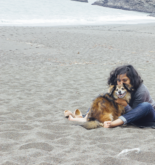 smiling dog, woman hugging dog on beach, Year of the Monkey, Babu and Paroma