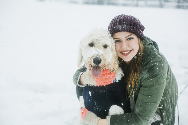 college student hugging dog, snowy portraits, NC lifesttyle photographer