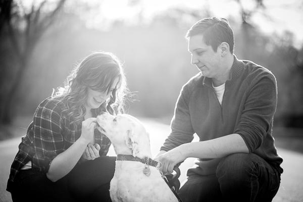lifestyle dog photography, dog getting treat, black, white dog photography