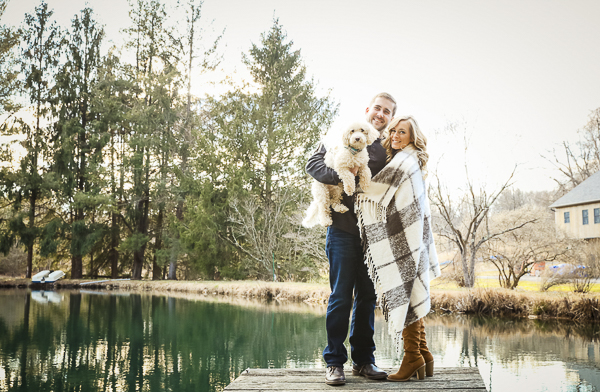 small white dog, couple on dock in small pond, engagement photos with dog