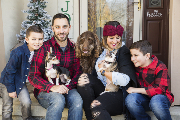 lifestyle family photos with dogs, making a difference by fostering pets