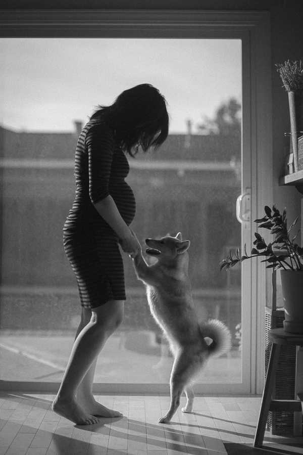 pregnant woman and dog dancing, black and white lifestyle family/pet photography