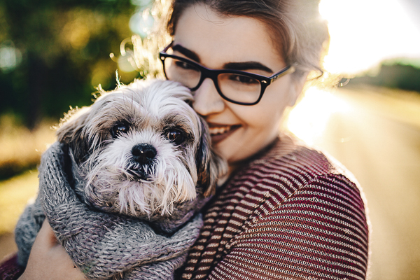 woman holding cute dog, end of life dog session