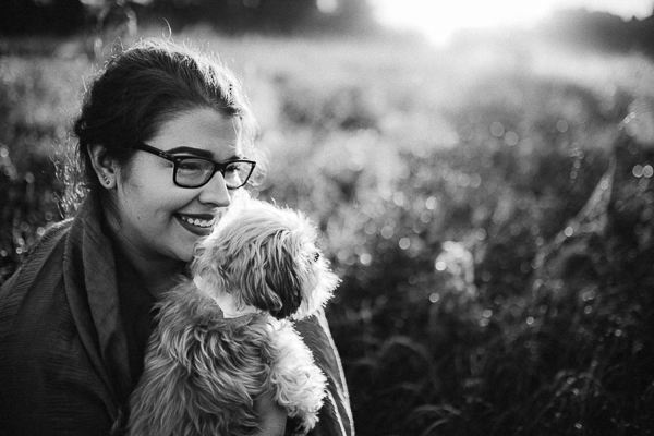 smiling woman holding senior dog, black white portraits
