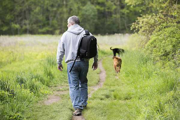 man hiking with dogs, lifestyle dog photographer