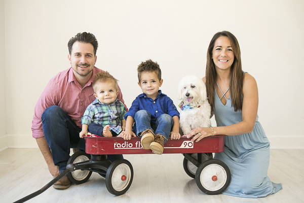 two little boys and dog in wagon between parents, family studio portraits