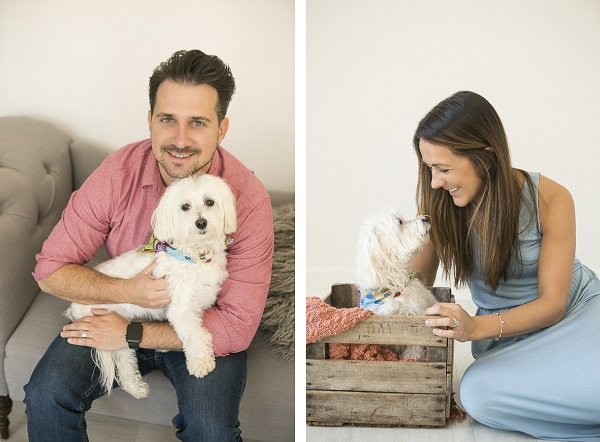 man's best friend, love between human and dog, man holding small white dog, woman looking at Havanese mix