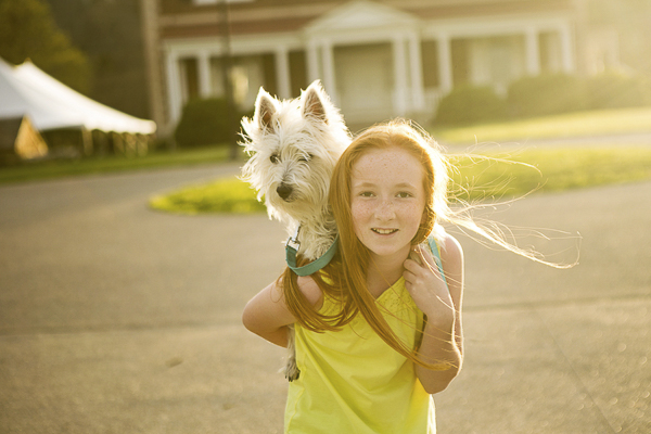 West Highland Terrier on girl's shoulders, a girl and her dog, bffs