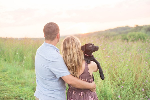 puppy looking over woman's shoulder, summer family portraits