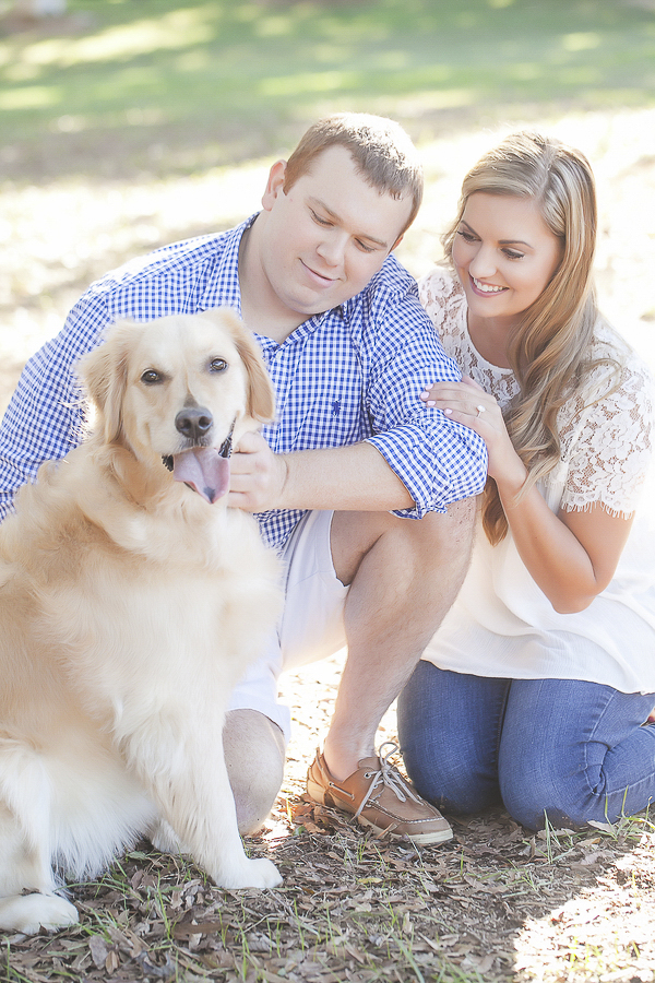 Golden Retriever looking at the camera, while owners look at her,
