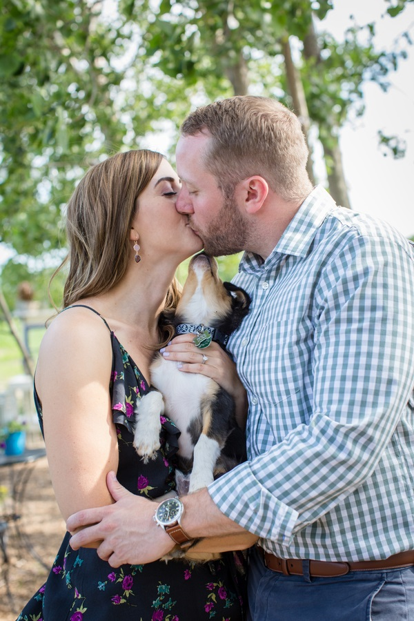 puppy joining in as couple kisses, engagement photos with puppy