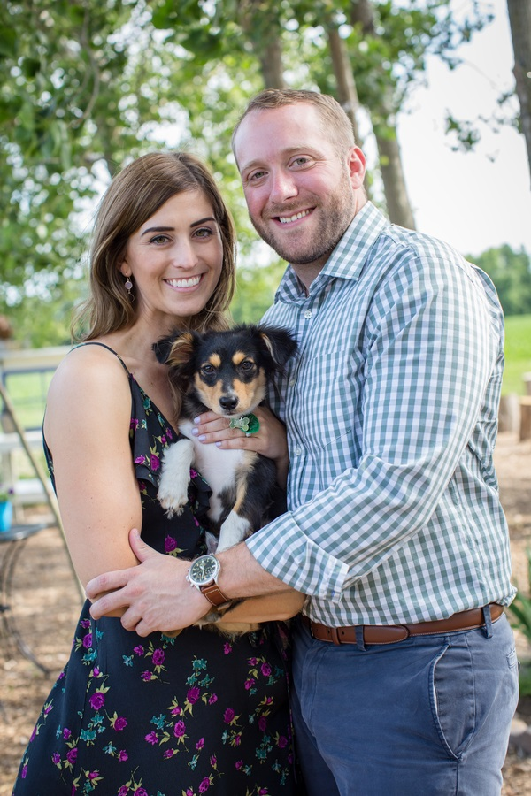 couple holding cute Chi mix puppy, ©Clicking Through Life Photography | Engagement photos with puppy