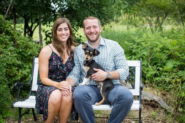 couple sitting on bench at Hops farm with puppy. ideas for dogs in engagement pictures