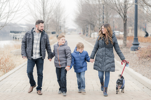 couple, two boys, dog walking on brick path, lifestyle winter engagement pictures,