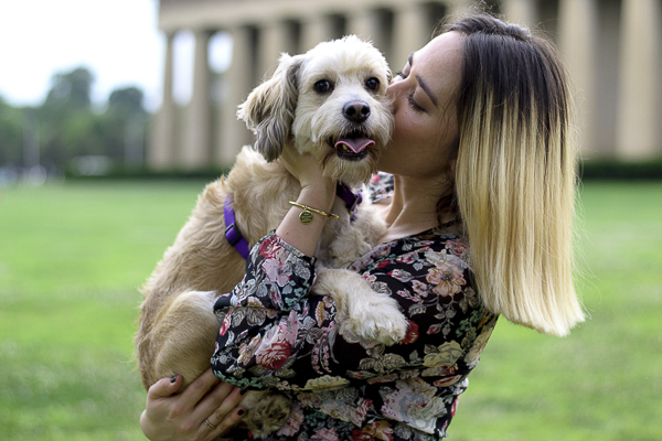 woman kissing spaniel mix in front of Parthenon, Nashville, TN