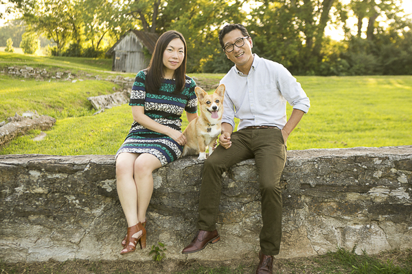 Corgi and her humans sitting on low wall, Harlinsdale Farm, Mandy Whitley Photography