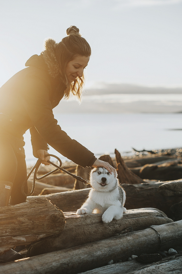 woman petting Siberian Husky puppy, on location pet photography, British Columbia