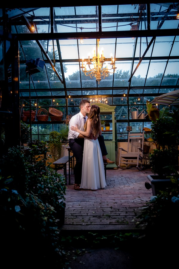 bride and groom kissing in greenhouse, end of the night shot, ©Sandy Rufio Photography | Calverton, NY wedding photographer