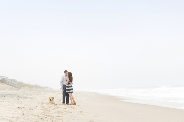 romantic engagement photos at the beach, dog lying in sand at the beach, ©Anna Grace Photography
