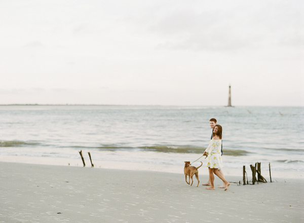 couple walking dog along empty beach, ©Rachel Craig Photography