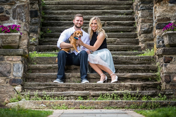 couple sitting on stone stairs with Beagle mix, engagement pictures with a dog