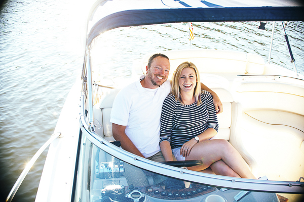 couple siting side by side on boat on Allegheny River, ©Jill Gearhart Photography | engagement photos with dogs on a boat