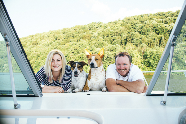 engagement photos on Allegheny River, people and dogs on boat