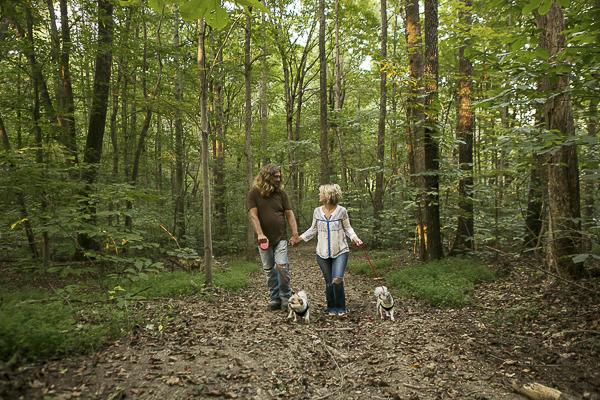 couple walking dogs through the woods, Shih Tzu mixes, Maltese mixes