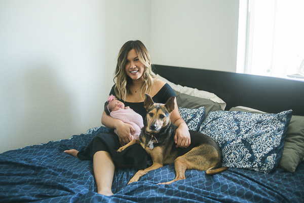 mom, newborn and dog on bed, ©Memory Layne Photography | newborn photos with dogs