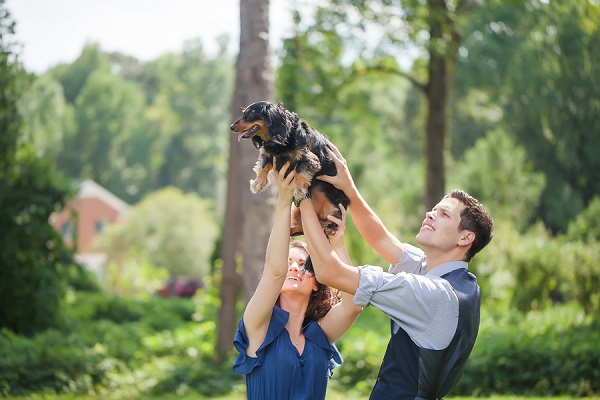 couple lifting Dachshund in the air, Lion King shot, ©Casey Hendrickson Photography, engagement photos with dog