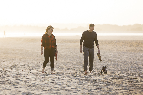 couple walking with puppy on the beach, ©Erin Costa Photography