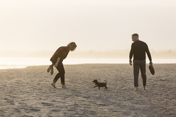 puppy playing on beach, Engagement photos Wrightsville Beach ©Erin Costa Photography