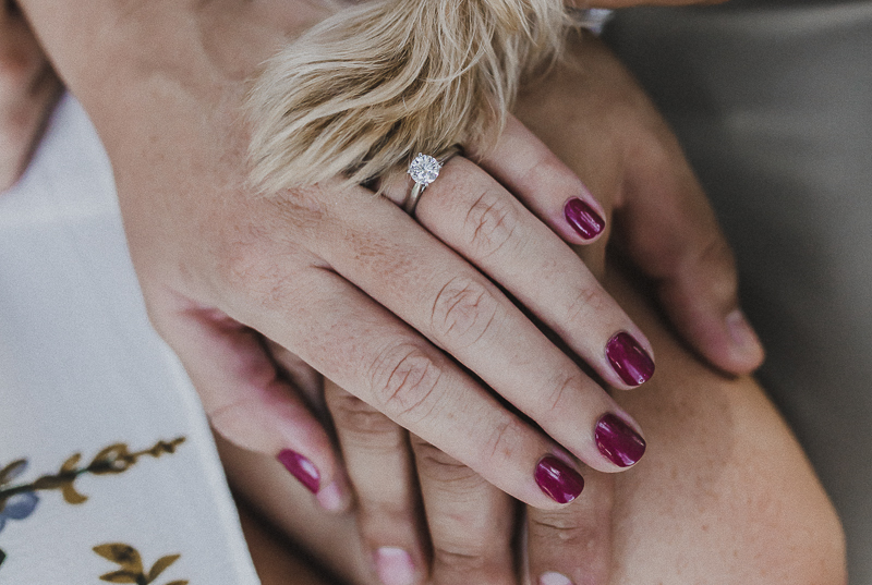 Yorkie paw, woman's engagement ring, couple's hands, dog friendly engagement photos