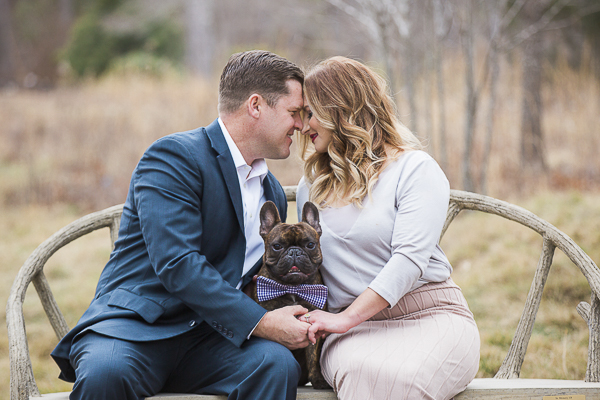 cute dog sitting between favorite people, engagement photos with dogs ©Meghan Rolfe Photography | Asheville, NC Engagement photos