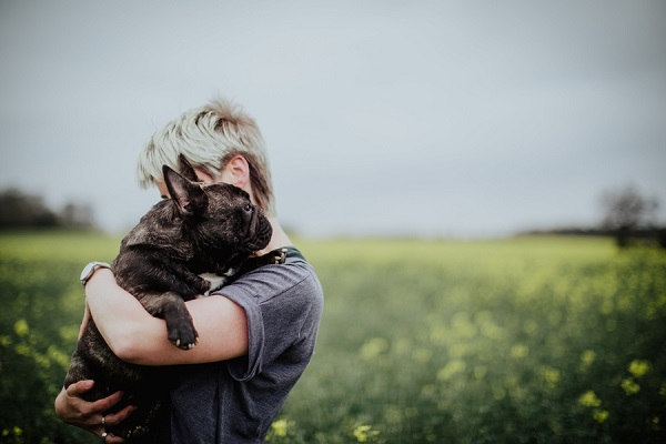 French Bulldog in woman's arms, human-dog bond, ©Wild Connections Photography | lifestyle photography