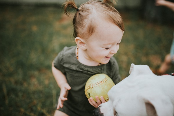toddler girl and her dog, ©Love Mary Beth Photography | Panama City, documentary dog photography