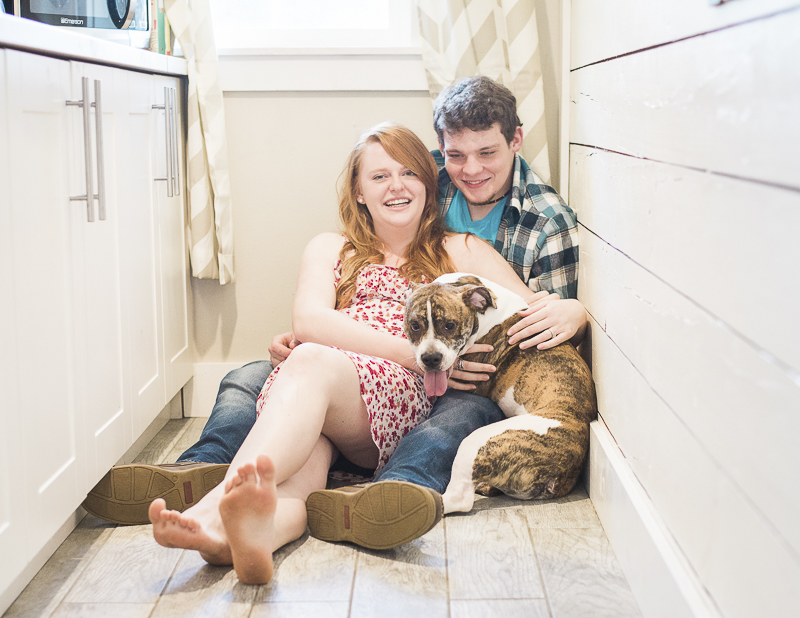 lifestyle portraits in home, couple on kitchen floor with dog
