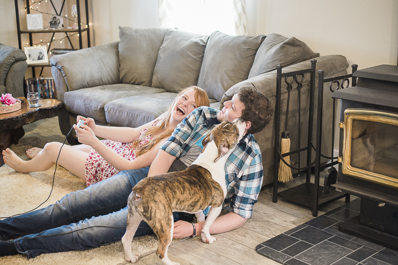 couple playing video games on the floor, dog, ©Laurie Jean Photography | lifestyle dog photography