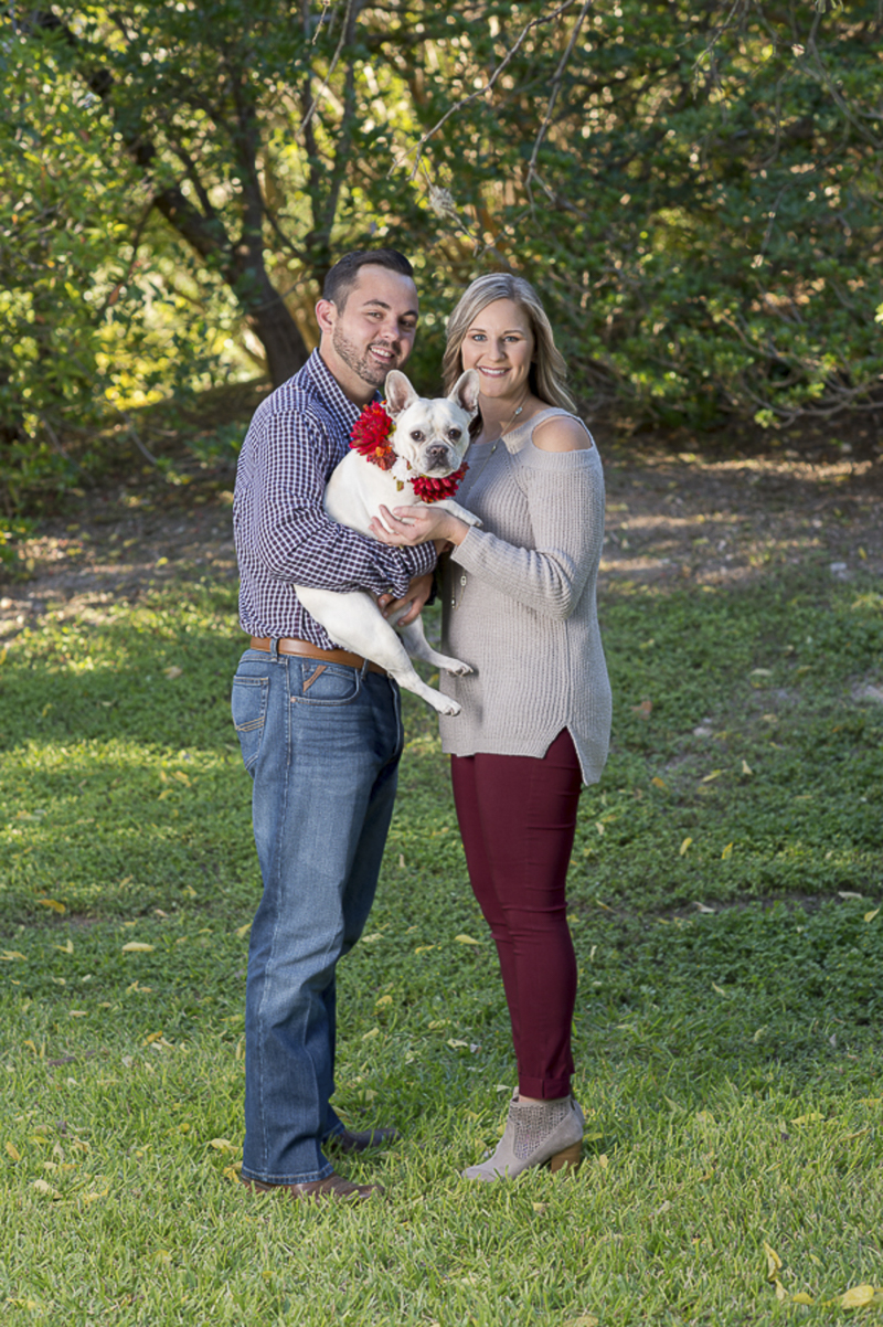 couple holding white French Bulldog, ©Ata-Girl Photography | San Antonio engagement photos with dog