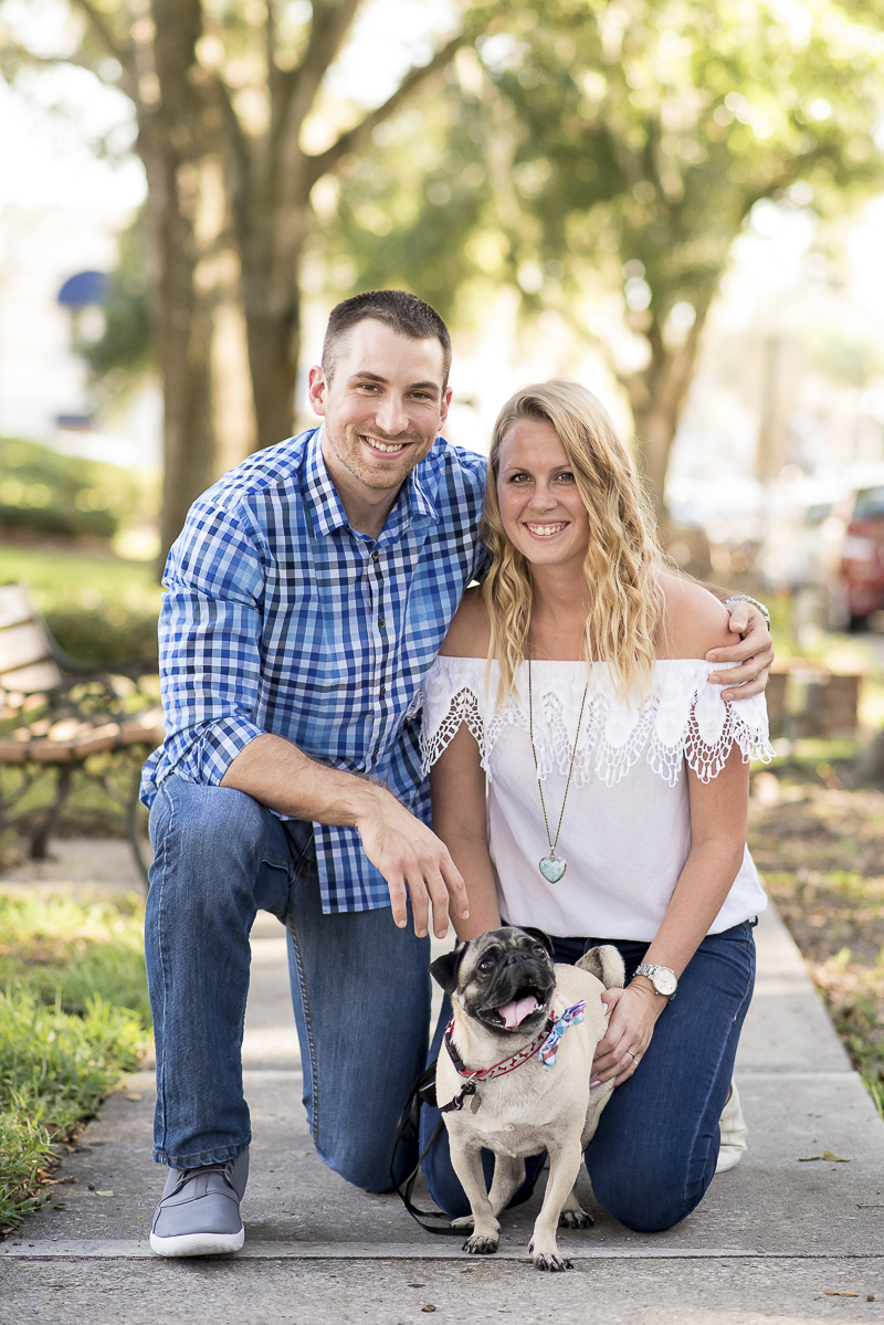 couple on sidewalk with Pug, engagement pictures with dog, ©Corner House Photography | Mount Dora dog friendly engagement session