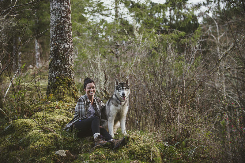 woman and her dog sitting on moss in forest, on location dog photography ©Laurie Jean Photography