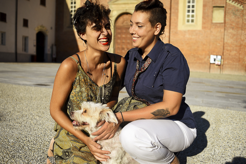 Maltese mix and humans in front of church, ©Martina Campola Photography | engagement photos with small dog, Alessandria, Italy