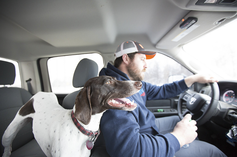 man's best friend, dog and man in vehicle, ©Art By Carly | Sioux Falls dog photography
