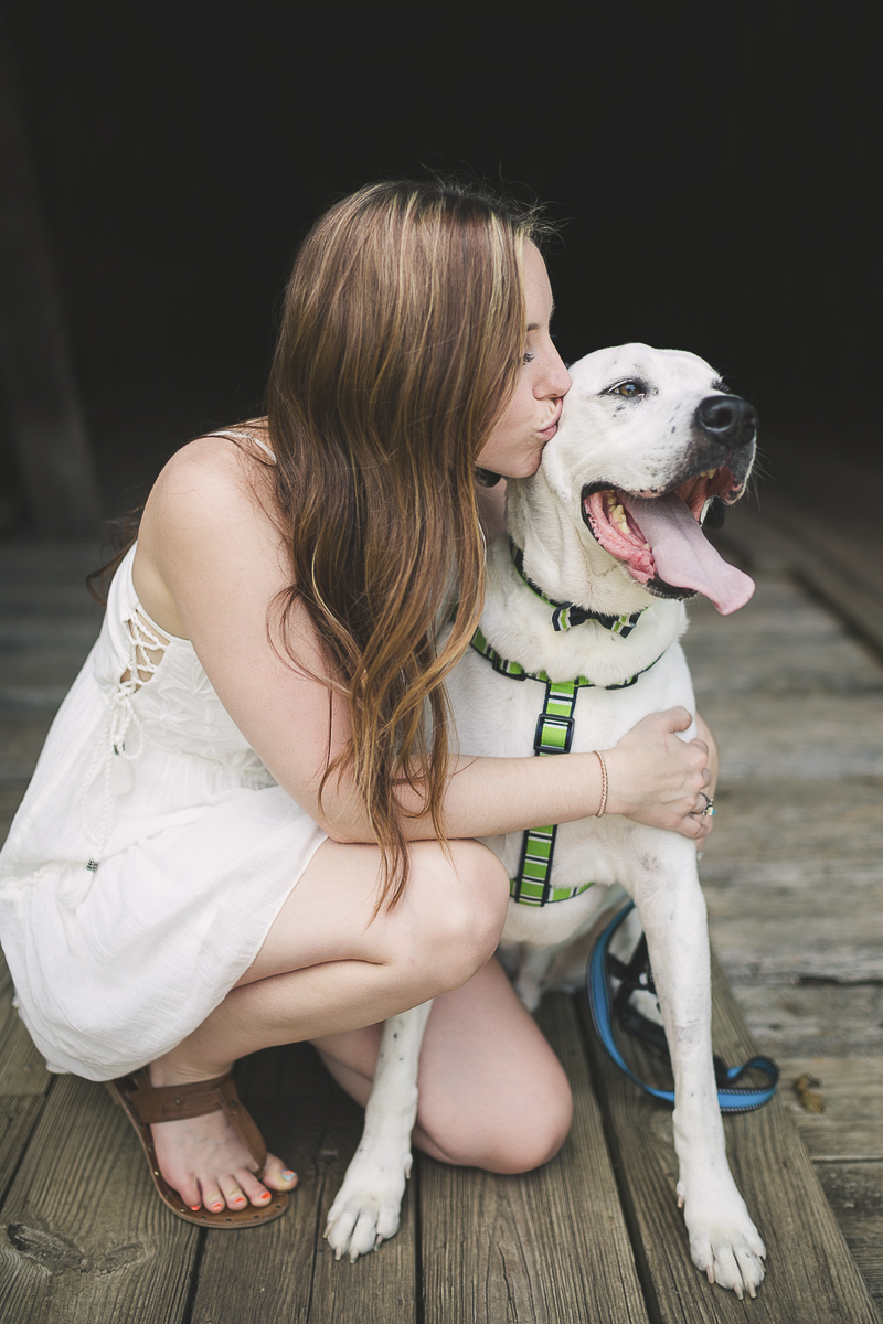 ©Brandy Angel Photography | woman kissing her mixed breed dog