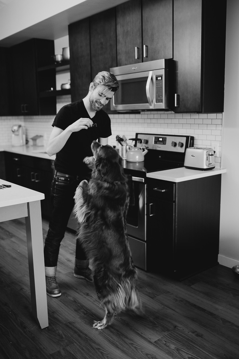 dog standing on hind legs with man in the kitchen ©Empiria Studios | lifestyle dog photography