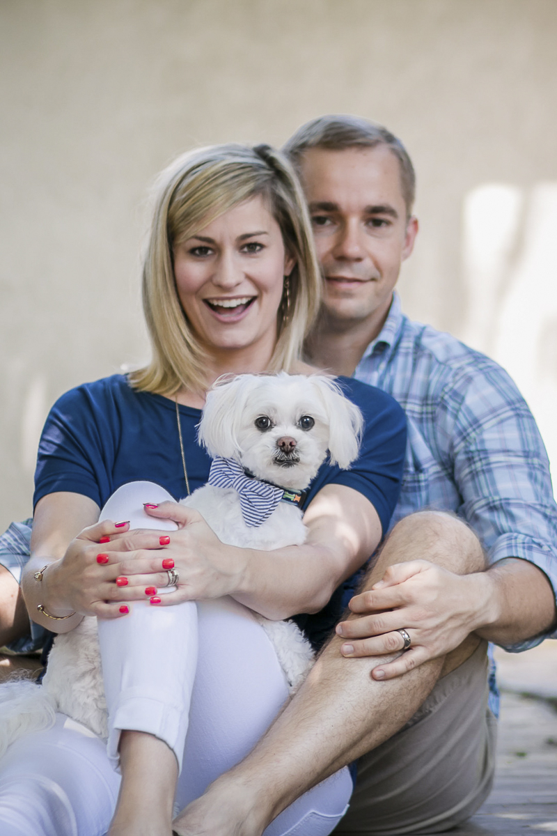 little white dog in woman's lap, family photos with a dog, ©Images by Amber Robinson- Raleigh anniversary photos with dog