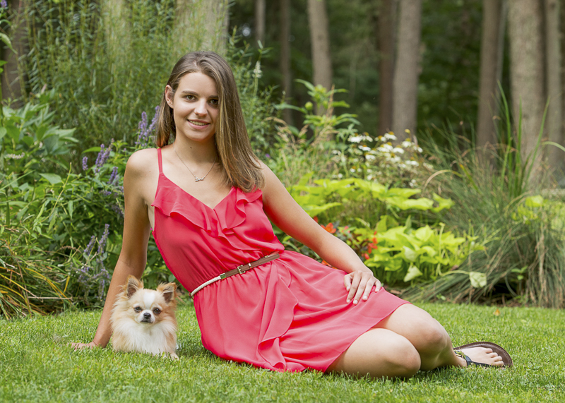 teen sitting next to adorable long haired Chi, senior portraits with dogs ©Trina Bauer Photography