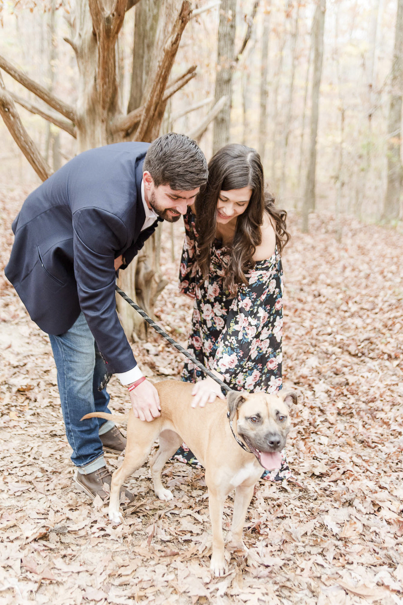 couple and their dog in the woods, ©Heather K Cook Photography | Atlanta dog friendly engagement portraits